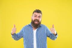 Great job. Man bearded hipster stylish beard yellow background. Barber tips maintain beard. Stylish beard and mustache. Care. Hipster appearance. Emotional stock photo