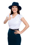 Great job!. Young woman in hat giving the camera a thumbs up Stock Photography
