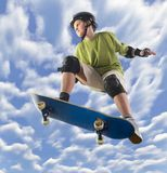 Great jump. Young skateboarder make a jump on skateboard. Unusual angle view - directly below Royalty Free Stock Photos