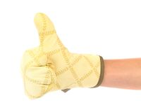 Great. Kitchen glove is put on the hand. Stock Photos