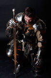 Great Knight Holding His Sword And Helmet Stock Photo