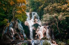 Great Kuang Si waterfall in Luang Prabang, Laos during summer season