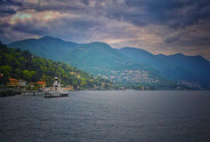 The great lake of COmo. A fall day on the lake of como with a boat stock photos
