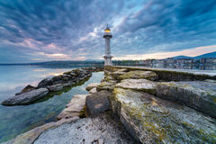 Great Lake Lighthouse Sunrise with Rocks Stock Images