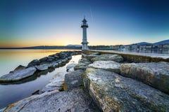 Great Lake Lighthouse Sunrise with Rocks Royalty Free Stock Photography