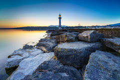 Great Lake Lighthouse Sunrise with Rocks Stock Photos