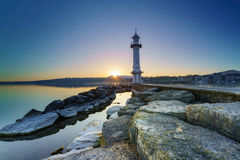 Great Lake Lighthouse Sunrise with Rocks Royalty Free Stock Photo