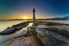 Great Lake Lighthouse Sunrise with Rocks. Geneva city, Switzerland Stock Photography