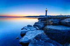 Great Lake Lighthouse Sunrise with Rocks Stock Photos