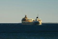 Great lakes freighter. A great lakes freighter transits round island passage Mackinac island Michigan Lake Huron Stock Photos