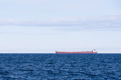 Great Lakes Freighter with Low Horizon Royalty Free Stock Image