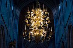 Great lamp with candles in church. Sweden, Europe Royalty Free Stock Photo