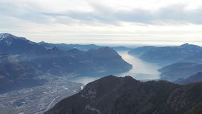 Great landscape at Iseo lake in winter season, foggy and humidity in the air. Panorama from Monte Pora, Alps, Italy. Great landscape at Iseo lake in winter stock video