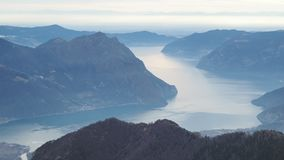 Great landscape at Iseo lake in winter season, foggy and humidity in the air. Panorama from Monte Pora, Alps, Italy. Great landscape at Iseo lake in winter stock video footage