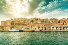 Great landscape with Valletta embankment and ships. With beautiful sky on the background, view fron the sea, Malta Royalty Free Stock Images