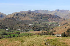 Great Langdale and mountains beyond from Loughrigg. Looking west from Loughrigg in the English Lake District, Cumbria, England to Great Langdale with Elterwater Royalty Free Stock Photos