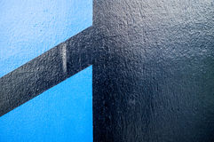 Great looking black wall with two blue shapes. Great as a background or wallpaper. Editing: more contrast, more colours, more clarity royalty free stock photos