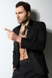 Great looking sexy male model with open shirt and loose Royalty Free Stock Photo