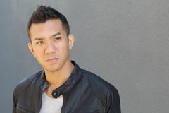Great looking tough asian guy royalty free stock image