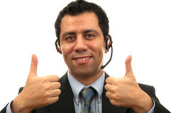 Great Male customer Service. Handsome Male Customer Service answering the phone while giving two thump up with his hand Stock Photography
