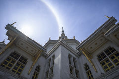A great marble church with sun halo and blue sky, Wat Sothorn, Chachoengsao Thailand Royalty Free Stock Photos