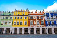 Great Market Square and colourful buildings, Zamosc, Poland stock photography