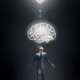Great mental ability. Businessman with hands spread wide and human brain above his head Royalty Free Stock Images