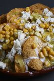 Great mexica nachos. Corn chips with cream corn, fresh cheese and jalapeño Royalty Free Stock Photos