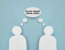 Great minds. Two paper figures with Great Minds Think Alike thought bubble Royalty Free Stock Image