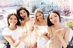 Positive joyful women looking at you Stock Photos