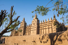The Great Mosque of Djenné, Mali, Africa. The Great Mosque of Djenné is the largest mud brick or adobe building in the world and is considered to be the Stock Photos