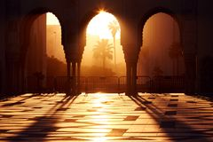 Great mosque of Hassan 2 at sunset in Casablanca, Morocco. Beaut. Iful Arches of the Arab mosque in the sunset, sunlight rays stock photo