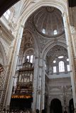 The Great Mosque or Mezquita famous interior in Cordoba, Spain. The Picture of the interior Great Mosque currently Catholic cathedral. UNESCO World Heritage Site stock photography