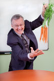 The great motivator dangling carrots Stock Image