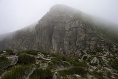 Great mountain peak in the fog Royalty Free Stock Photo