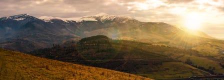 Great mountain ridge Borzhava at sunset. Great mountain ridge Borzhava with snowy tops at sunset. beautiful countryside landscape in late autumn Royalty Free Stock Image