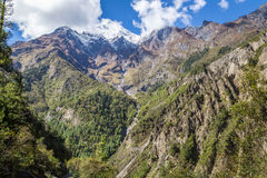 Great mountains with trees and a river coming down from the top. View from the trekking at Annapurnas circuit, Nepal Stock Image