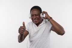 Joyful happy man showing OK gesture. Great music. Joyful happy man showing OK gesture while enjoying the music Stock Photos