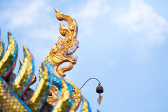 Great naga statue on the top of temple Stock Image