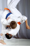 Great nage judo is doing sportsman with a blue belt Royalty Free Stock Photos