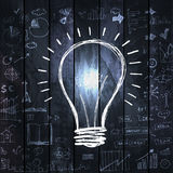 Great new idea concept - bulb with hand draw business doodles on dark wooden background Stock Photos