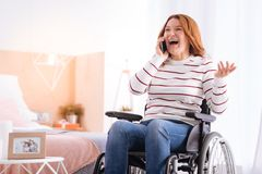 Alert smiling handicapped woman talking on the phone Royalty Free Stock Image