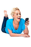 Great News by Text Message on Cell Phone Royalty Free Stock Photography