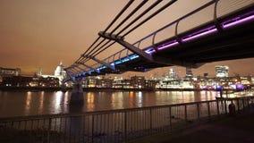Great night shot of colorful illuminated Millennium Bridge London. LONDON, ENGLAND stock video