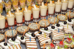 Great number of snacks on banquet table Stock Photo