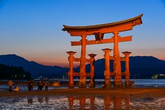 Torii Gate of Itsukushima Shrine. The great O-Torii of Itsukushima Shrine. Tourists walk around the famous tori gate of the Itsukushima Shrine on Miyajima Island royalty free stock image