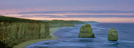 Great ocean road sunrise. Rocks formations in the sea in a cold morning Stock Images