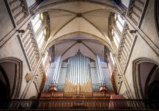 Great organ under arch in catholic church. Stock Photo