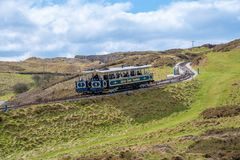 Great Orme Tramway. LLANDUDNO, WALES - APRIL 14th, 2018: The Great Orme Tramway trams passing each other. It is the only surviving cable operated street railway Royalty Free Stock Photos