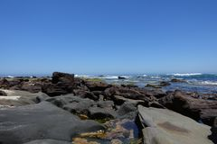Great Otway National Park coastline during low tide and no clouds at the sky. stock photos